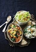 Oriental stir-fried vegetables with rice and a cabbage salad