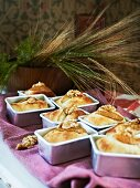 Pear and walnut bread in baking dishes