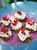 Chocolate crispy cakes with cream and redcurrants