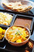 Navratan korma with curried potatoes, rice, lentils and naan bread