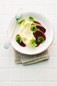 Mashed potatoes and celery with saddle of venison and Brussels sprouts