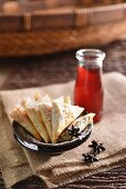 Triangular puff pastries with nuts, spices and rose syrup