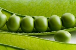Fresh peas in an opened pod