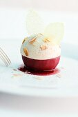 A poached mulled wine apple with gingerbread mousse