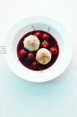 Sour cherry soup with quark dumplings and gingerbread crumbs