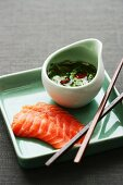 Salmon sashimi with coriander and lime sauce