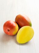 Keitt mangos from Florida, whole and halved