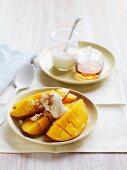 Mango wedges with yogurt and maple syrup