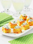 Corn cake squares with smoked salmon and chive cream