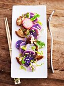 Oriental potato salad made with blue potatoes and shiitake mushrooms