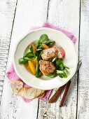 Pork medallions with lamb's lettuce and citrus fruits
