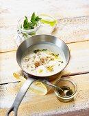 Yogurt soup with chicken and pesto