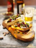 Montaditos with cheese, cherry tomatoes and nuts (Spain)