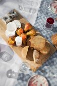 A cheese platter with pears on a garden table