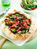 Mushroom pizza with olives and tomatoes