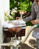 Lemongrass lemonade in picnic basket on bicycle in garden