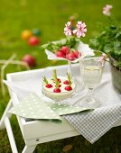 A radish snack with an olive dip for a croquet garden party