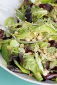 Mixed leaf salad with avocado and a hazelnut dressing