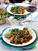 Leg of lamb wrapped in bread with vegetables and mint sauce