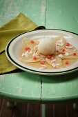 Geranium sorbet on a pear and lychee salad