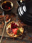 A vanilla cream tartlet with strawberries