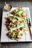 Crispy unleavened bread with chicken and cucumber