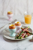 Soft-boiled eggs with Parma ham-wrapped asparagus