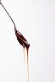 Caramel dripping from a teaspoon