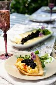 Melba toast topped with egg cream and caviar