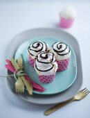 Vanilla cupcakes with meringue and chocolate sauce
