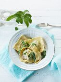 Ravioli with spinach and minced meat filling and sage butter