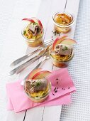 Potato gratin in glasses with prime boiled beef and apple