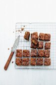 Brownies with chopped nuts on a wire rack