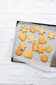 Various Christmas biscuits on a baking tray