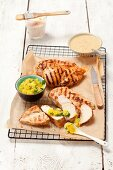 Grilled chicken breast with mango sauce and peanut sauce