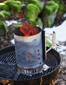 A barbecue starter chimney in winter