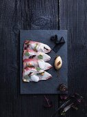 Raw hamachi on a fish platter
