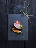 Hamachi with a spring roll and umibudo seaweed