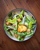 Caesar salad with a deep-fried egg