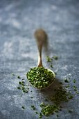 Dried chives on a spoon