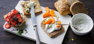 ADHD food: a bread roll topped with strawberries and bread topped with yoghurt and apricots