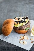 An ostrich burger with avocado cream and cranberry sauce