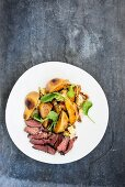 Marinated ostrich fillet with a pear and gorgonzola salad