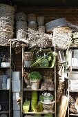 Wicker baskets and plant pots stacked on a shelf