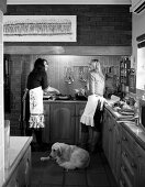 Two women cooking in the kitchen