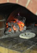 Unleavened bread in a wood-fired oven