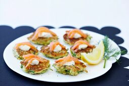 Courgette fritters topped with smoked salmon