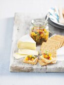 Mango chutney with Camembert and crackers for a picnic