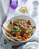 A bowl of chicken tagine with apricots and almonds