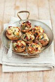 Mushrooms stuffed with mozzarella, dried tomatoes, black olives and herbs